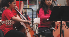 Students at the Community Music Center playing the cello